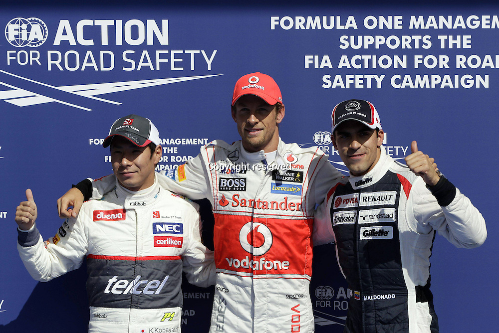 01 09 2012  Kamui Kobayashi F1 clean, Jenson Button McLaren Mercedes and Pastor Maldonado Williams After Qualifying in Spa GP Belgium 2012 Formula 1 Grand Prix Button took pole