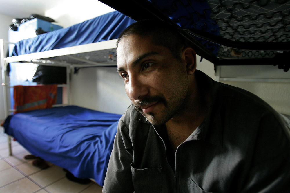 A recovering Heroin addict, who chose to remain anonymous, sits on his bunk at the Los Tesoros Escondidos Drug Rehabilitation Center in Tijuana, Mexico