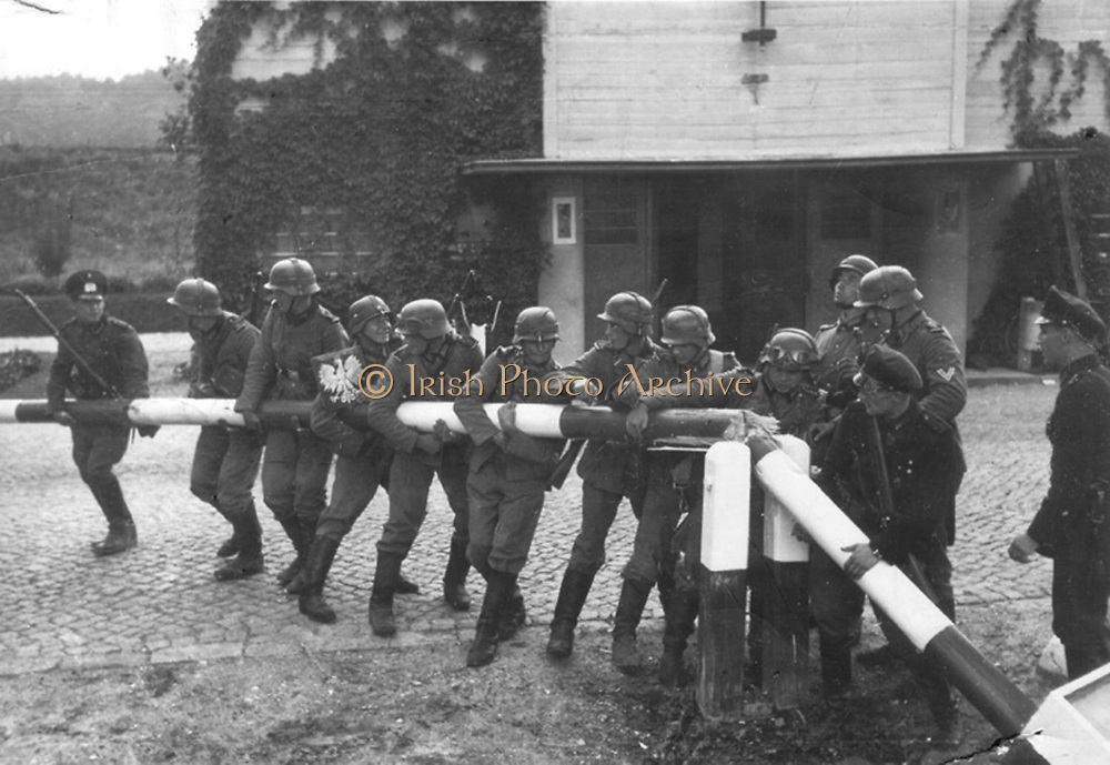 German Soldiers breaking down the border barrier and crossing into Poland at Sopot on September 1, 1939.
