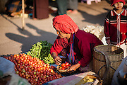 Tribal woman buying tomatoes at local market in Kalaw (Myanmar)