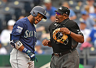 Seattle Mariners second basemen Robinson Cano (left) argues a called third strike with home plate umpire Laz Diaz (right) in the third inning against the Kansas City Royals at Kauffman Stadium.