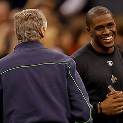November 21, 2010; New Orleans, LA, USA; New Orleans Saints running back Reggie Bush (25) talks with Seattle Seahawks head coach Pete Carroll during warm ups prior to kickoff of a game at the Louisiana Superdome. The Saints defeated the Seahawks 34-19. Mandatory Credit: Derick E. Hingle
