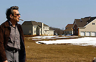 MILLSTONE NJ -  Developer Gerry Baldachino, stands by one of the units his company is building up in Millstone.  (Photo by Miguel Juárez Lugo)