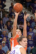 Idaho State guard Jeni Boesel (C) fires a shot over Kansas State's Jessica McFarland (50) during the first half at Bramlage Coliseum in Manhattan, Kansas, March 17, 2006.  K-State defeated the Bengals 88-68 in the first round of the WNIT.