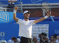 Tennis - 2017 Aegon Championships [Queen's Club Championship] - Day Two, Monday<br /> <br /> Men's Singles, Round of 32<br /> Andy Murray [GBR] vs. Jordan Thompson [Aus]<br /> <br /> Jordan Thompson celebrates winning the biggest game of his career over the no 1 in the World, Andy Murray on Centre Court <br /> <br /> COLORSPORT/ANDREW COWIE