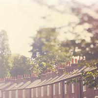 Chimney pots on top of old worker's cottages in Cambridge, England