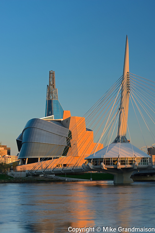 Canadian Museum for Human Rights (CMHR) and the Esplanade Riel Bridge over the Red River at sunrise<br /> Winnipeg<br /> Manitoba<br /> Canada