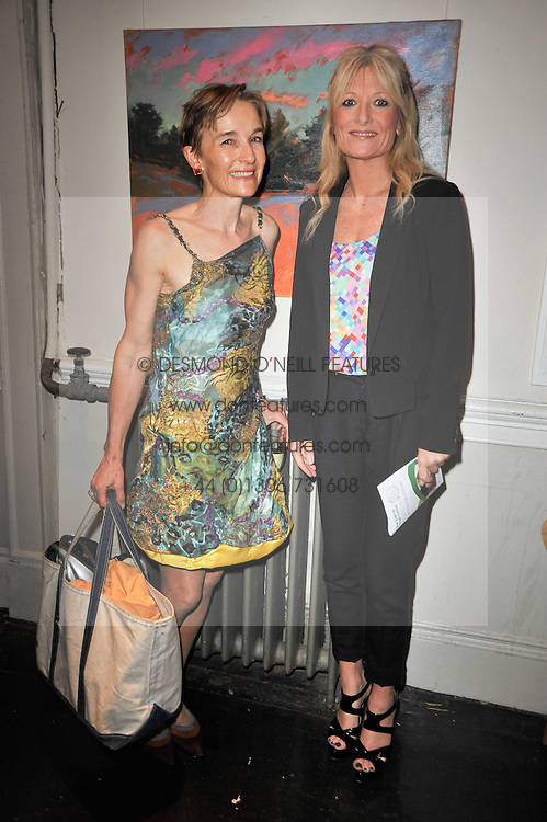 Left to right, contributing artist SARAH BUTTERFIELD and GABY ROSLIN at The Special Yoga Centre's annual art auction held at the 20th Century Theatre, 291 Westbourne Grove, London W11 on 16th May 2011.