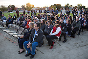 Guests listen to a presentation during the Milpitas Unified School District and San Jose Evergreen Community College District Community College Extension Ground Breaking Ceremony near Russell Middle School in Milpitas, California, on November 17, 2015. (Stan Olszewski/SOSKIphoto)