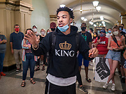 15 JUNE 2020 - DES MOINES, IOWA: MATTHEW BRUCE, a leader of Black Lives Matter in Des Moines, leads a protest in the Iowa capitol in Des Moines. About 75 supporters of Black Lives Matter marched through the Iowa capitol Monday to demand the restoration of voting rights for felons who have completed their sentences. Iowa is one of only two states in the US that permanently strip felons of voting rights. The issue is a  racial one in Iowa. Blacks make up only 4 percent of the population but 25 percent of the prison population. The Governor agreed to meet with a delegation of the protesters but she would not commit to immediately restoring voting rights. She said would draft an executive order to restore voting rights later in the summer.    PHOTO BY JACK KURTZ