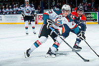 KELOWNA, CANADA - FEBRUARY 6: Ryan Rehill #24 of Kamloops Blazers checks Justin Kirkland #23 of Kelowna Rockets during the first period on February 6, 2015 at Prospera Place in Kelowna, British Columbia, Canada.  (Photo by Marissa Baecker/Shoot the Breeze)  *** Local Caption *** Ryan Rehill; Justin Kirkland;