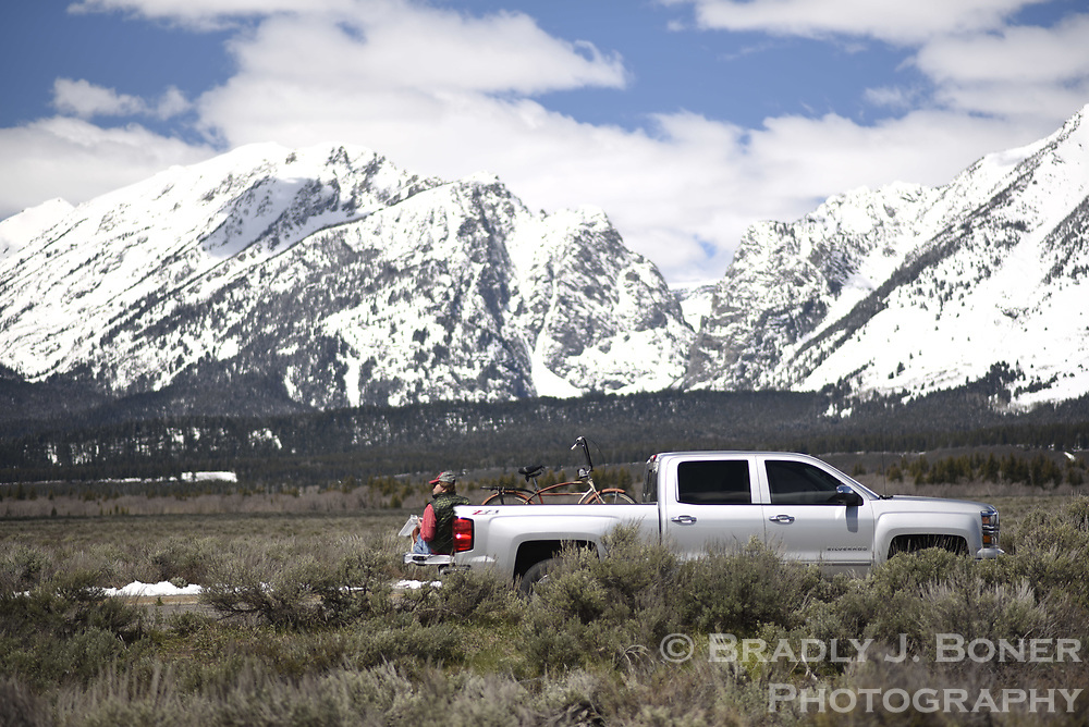 Steve Fishbach eating lunch off the back of his truck in Grand Teton National Park