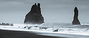 Reynisdrangar basalt sea stacks (troll rocks) and black volcanic sand beach Reynisfjara near the village Vík i Myrdal, South Iceland