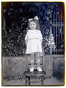little girl posing for a picture France 1900s glass plate