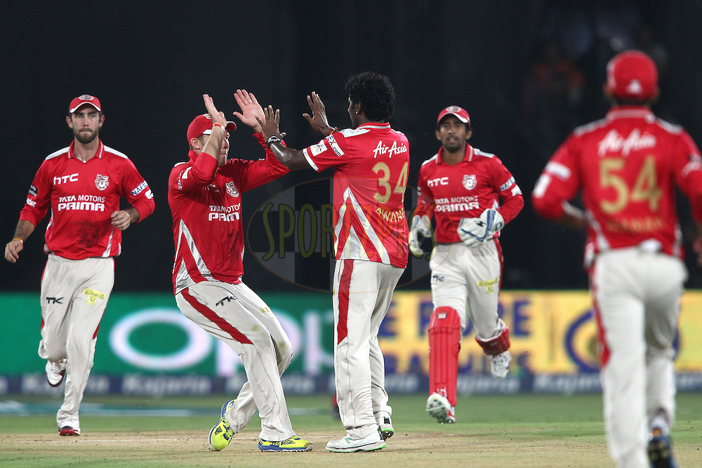 David Miller of the Kings XI Punjab congratulates Parvinder Awana of the Kings XI Punjab for bowling Dwayne Smith of the Chennai Super Kings during the second semi final match of the Oppo Champions League Twenty20 between the Kings XI Punjab and the Chennai Superkings held at the Rajiv Gandhi Cricket Stadium, Hyderabad, India on the 2nd October 2014<br /> <br /> Photo by:  Shaun Roy / Sportzpics/ CLT20<br /> <br /> <br /> Image use is subject to the terms and conditions as laid out by the BCCI/ CLT20.  The terms and conditions can be downloaded here:<br /> <br /> http://sportzpics.photoshelter.com/gallery/CLT20-Image-Terms-and-Conditions-2014/G0000IfNJn535VPU/C0000QhhKadWcjYs