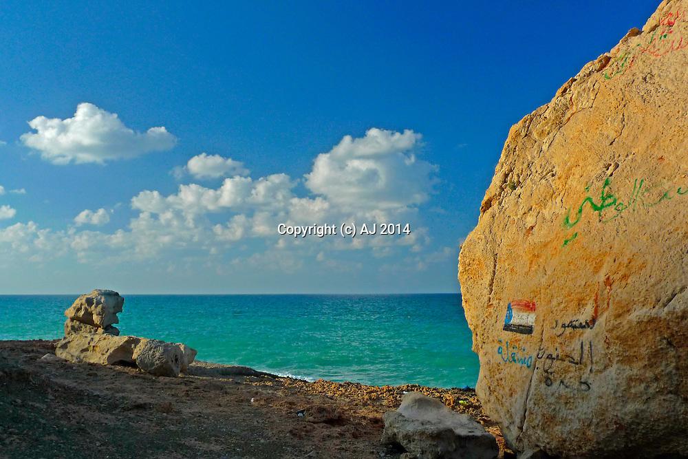 Writing and artwork on coastal boulder - Socotra, Yemen