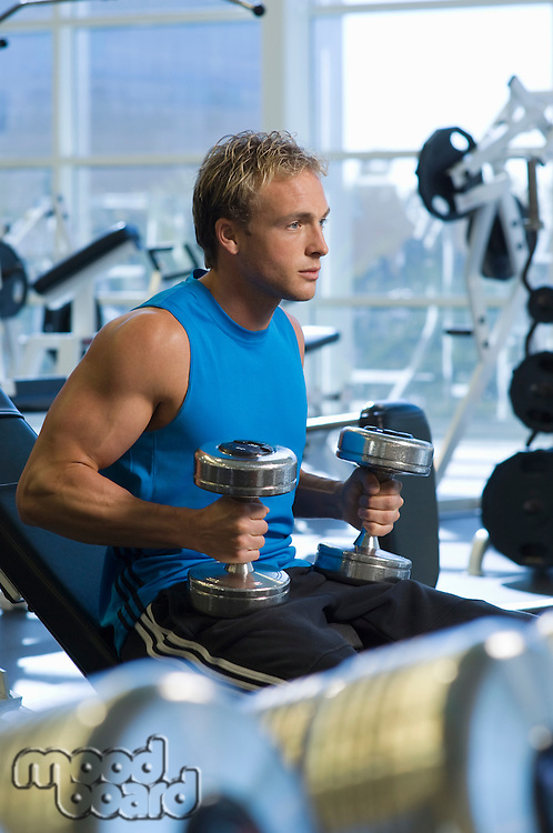 Man Weightlifting With Dumbbells