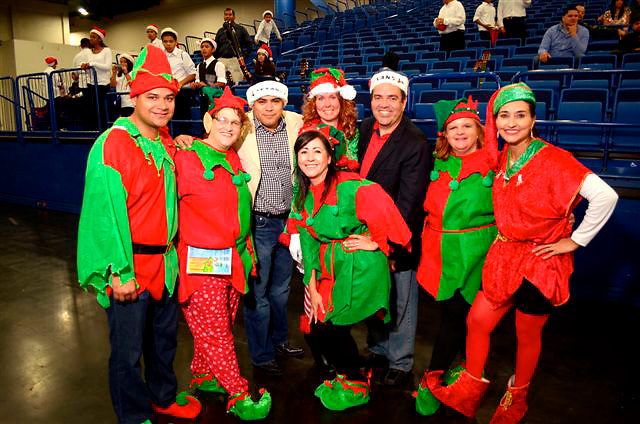 "Principals, teachers, and other volunteers helped 2,000 of the district's neediest students through a community service project called Navidad en el Barrio, held Dec. 15 at the George R. Brown Convention Center. There, the students were treated to a free meal, entertainment, a special visit from ""Pancho Claus,"" and the exciting arrival of Santa Claus, who rolled into the venue in style on a Harley Davidson, escorted by Houston police officers. Santa then distributed gifts to the children based on what they had wished for.<br />