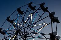 Ferris wheel silhouetted against a deep blue sky at twilight, Blue Hill Fair, Maine.