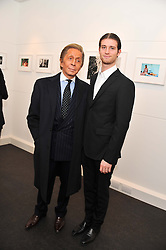 Left to right, Designer VALENTINO GARAVANI and ANTHONY SOUZA at a private view of photographs by Anthony Souza held at The Little Black Gallery, 13A Park Walk, London SW10 on 13th December 2011.