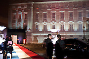 BUCKINGHAM PALACE PROJECTED ONTO BUILDING IN SOUTH LONDON. DESIGNED BY JEAN-PAUL GAULTIER,  Grey Goose character and cocktails. The Elton John Aids Foundation Winter Ball. off Nine Elms Lane. London SW8. 30 October 2010. -DO NOT ARCHIVE-© Copyright Photograph by Dafydd Jones. 248 Clapham Rd. London SW9 0PZ. Tel 0207 820 0771. www.dafjones.com.
