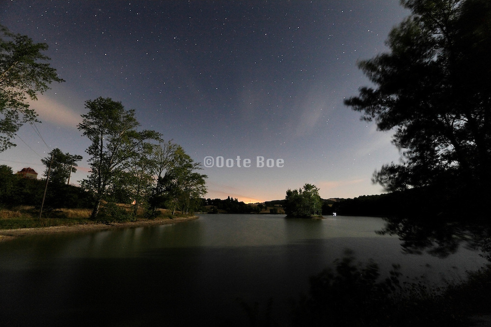 night view of small lake during full moon