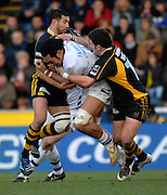 Wycombe, GREAT BRITAIN,  Baths, Jonathan FAAMATUAINU,goes for the gap,between left Riki FLUTEY and Rob WEBBER, during the Guinness Premiership game London Wasps v Bath Rugby, at Adams Park, Bucks  29/12/2007 [Mandatory Credit Peter Spurrier/Intersport Images]