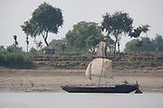 A boat sailing up stream on the river Ganges from Varanasi, Uttar Pradesh, India