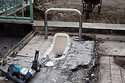 old style squatting toilet being torndown
