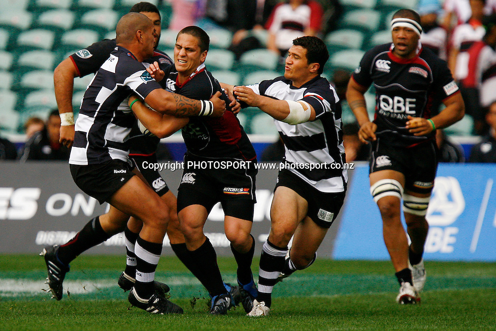 North Harbour's Ben Botica is tackled. Air NZ Cup Rugby Union Match. North Harbour v Hawkes Bay. North Harbour Stadium, Albany, Auckland, New Zealand. Saturday 12th September 2009. Photo: Anthony Au-Yeung/PHOTOSPORT