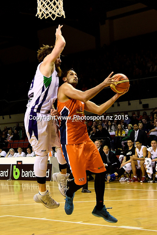 Tai Wesley (R of the Southland Sharks jumps to shoot with Casey Frank of the Super City Rangers during the NBL semi final basketball match between Southland and Super City Rangers at the TSB Arena in Wellington on Saturday the 4th of July 2015. Copyright photo by Marty Melville / www.Photosport.nz