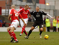 Photo: Leigh Quinnell.<br /> Nottingham Forest v Swansea. Coca Cola League 1. 11/02/2006. Nottingham Forests Danny Culip(L) and Sammy Clingan keep an eye on Swanseas Lee Trundle.