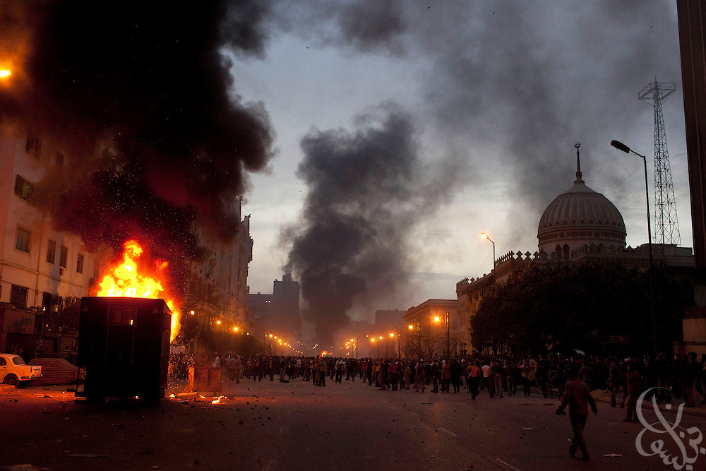 Police vehicles burn along Ramsis street in downtown Cairo, as thousands of protesters roam the streets during demonstrations January 28, 2011 across Cairo, Egypt . The protests, inspired by the recent revolution in Tunisia, have struck a chord with Egypt's population, tired of inflation, high unemployment and alleged corruption within the Mubarak government..Slug: Egypt.Credit: Scott Nelson for the New York Times