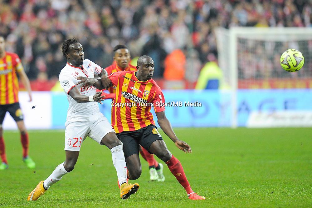 Pape Souare / Adamo Coulibaly - 07.12.2014 - Lens / Lille - 17eme journee de Ligue 1<br />Photo : Andre Ferreira / Icon Sport
