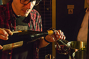 Wine director Richard Cappiello deccants a bottle of wine.