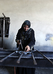 October 18, 2016 - Nablus, West Bank, Palestinian Territory - A Palestinian woman Ranim Safadi, 30-year-old, works at the metal workshop in the West bank village of Urif, near Nablus, on Oct. 18, 2016. Safadi is the first woman in the West bank works at the field of blacksmithing with her husband  (Credit Image: © Nedal Eshtayah/APA Images via ZUMA Wire)
