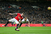 Manchester United Defender Phil Jones battles with Harry Kane of Tottenham Hotspur and heads clear during the Premier League match between Tottenham Hotspur and Manchester United at Wembley Stadium, London, England on 31 January 2018. Photo by Phil Duncan.