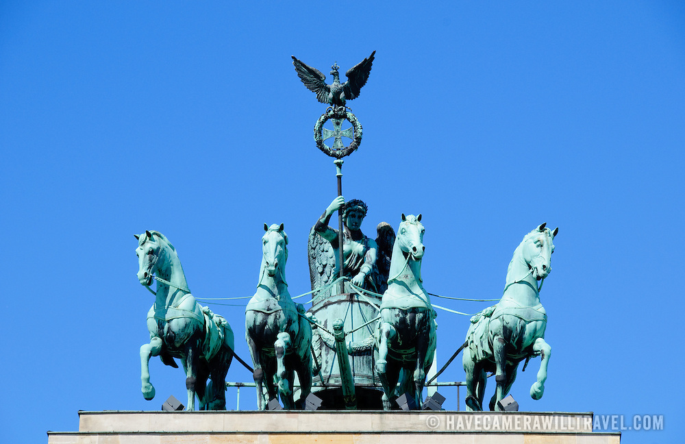 Quadriga Statue of Roman Goddess of Victory Victoria atop Brandenburg Gate in Berlin, Germany.