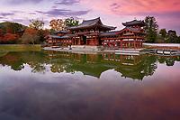 Peaceful autumn scenery of the Phoenix Hall, Amida hall of Byodoin temple on Kojima island of Jodoshiki teien, Pure Land garden pond. Uji, Kyoto Prefecture, Japan 2017