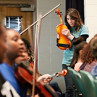 Thomas Wells | BUY at PHOTOS.DJOURNAL.COM<br /> Katri Gilbert make sure a violin is in tune before Tupelo fifth graders get a chance to perform along with the Tupelo Symphony Orchestra on Friday.