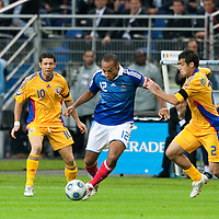 05 September 2009: French forward and captain Thierry Henry vies with Romanian defender Vasile Maftei during the World Cup 2010 qualifying football match France vs. Romania (1-1), on September 5, 2009 at the Stade de France stadium in Saint-Denis, near Paris, France.