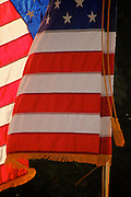 Closeup photo by Leandra Lewis of  United States of America flag, flowing in the breeze carried in a parade.