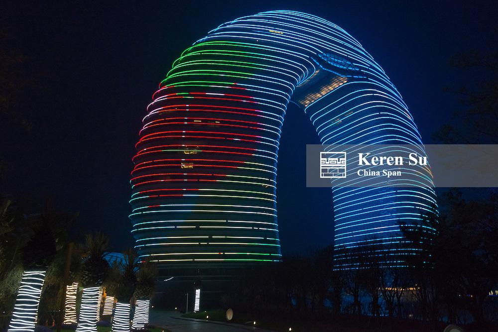 Night view of horseshoe shaped Sheraton Huzhou Hot Spring Resort on Lake Taihu, Huzhou, Jiangsu Province, China