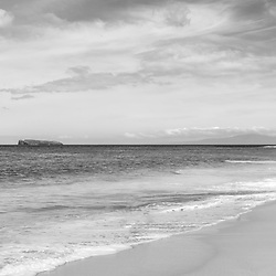 Maui Hawaii Makena Big Beach black and white panorama photo. Big Beach is in Wailea-Makena Kihei Hawaii and is one of Maui's most popular beaches. Panoramic photo ratio is 1:3. Copyright ⓒ 2019 Paul Velgos with All Rights Reserved.