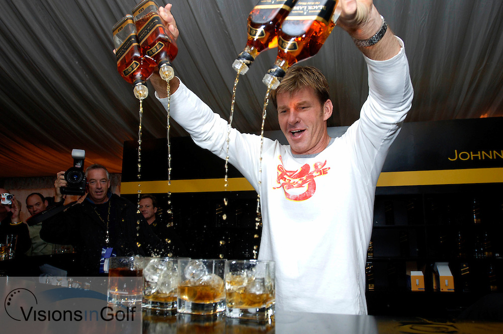 21 April 2005. Johnnie Walker Classic, Pine Valley Golf Club, Beijing, China. Nick Faldo pours four bottle od scotch at the same time during the player barmen evening.<br />
