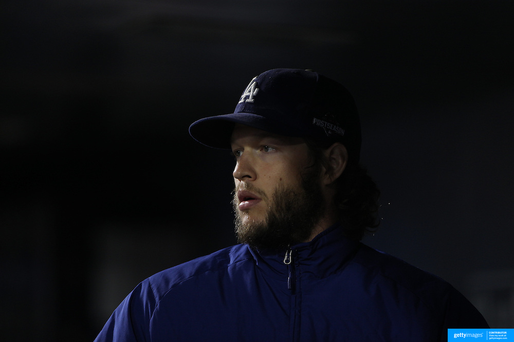 Pitcher Clayton Kershaw, Los Angeles Dodgers, in the dugout before pitching during the New York Mets Vs Los Angeles Dodgers, game four of the NL Division Series at Citi Field, Queens, New York. USA. 13th October 2015. Photo Tim Clayton