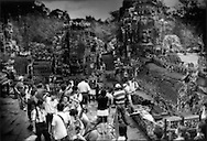 A throng of package tourists swarm over Bayon Temple at the Angkor Temple complex, Cambodia.  Since 2002, the photographer's first trip, the number of package tourists have swelled.