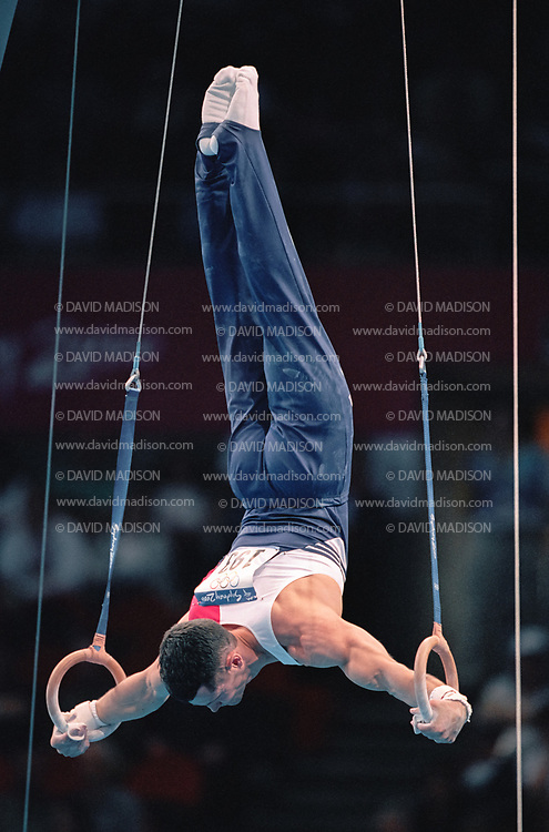 SYDNEY - SEPTEMBER 1:  John Roethlisger of the United States competes on the still rings during the Men's Gymnastics events of the Olympic Games during September 2000 in Sydney, Australia.  (Photo by David Madison/Getty Images)