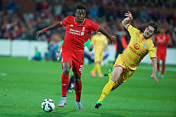 ADELAIDE, AUSTRALIA - Monday, July 20, 2015: Liverpool's Divock Origi in action against Adelaide United's Dylan McGowan during a preseason friendly match at the Adelaide Oval on day eight of the club's preseason tour. (Pic by David Rawcliffe/Propaganda)