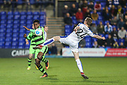 Forest Green Rovers Dale Bennett(6) is tackled by Tranmere Rovers Jeff Hughes(24) during the Vanarama National League match between Tranmere Rovers and Forest Green Rovers at Prenton Park, Birkenhead, England on 11 April 2017. Photo by Shane Healey.